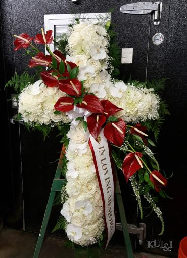White Cross with Red Anthurium Accents