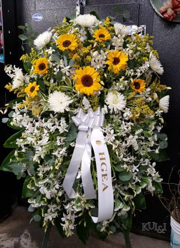 White Standing Spray Accented with Sunflowers
